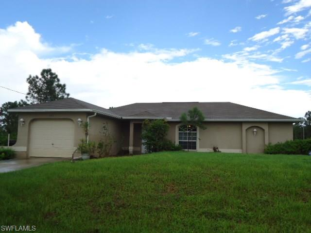 571 Hawthorne Ave S, Lehigh Acres, FL 33974