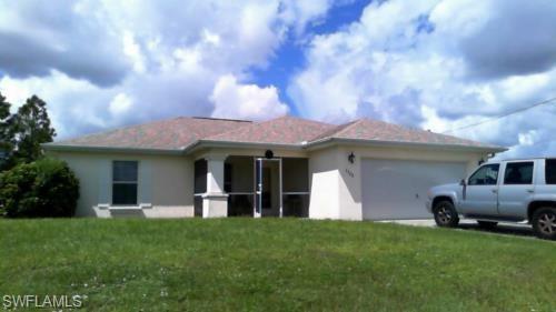 879 Asher St E, Lehigh Acres, FL 33974