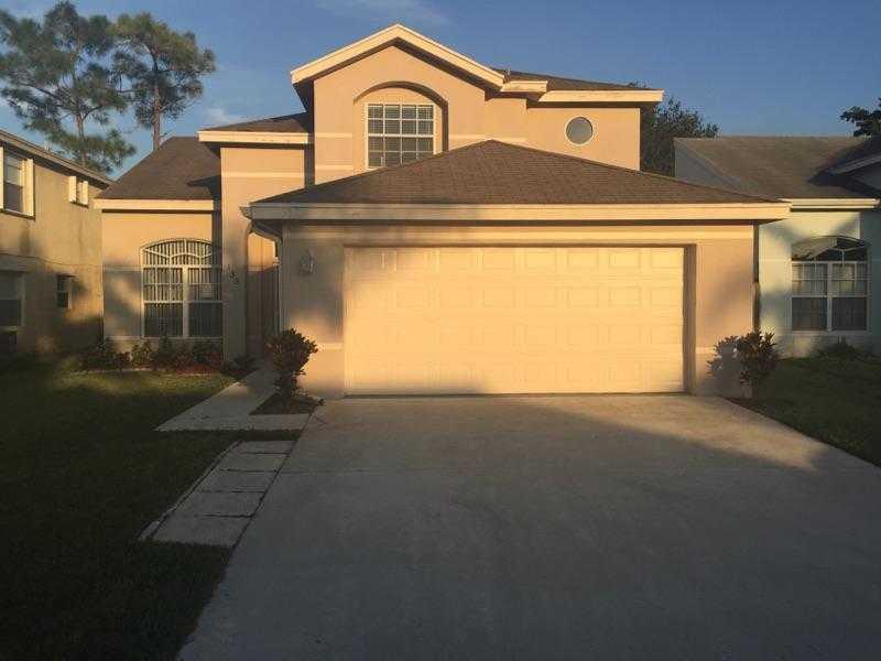 135 Heatherwood Drive, Royal Palm Beach, FL 33411