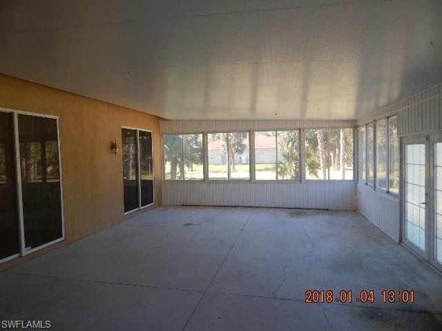 703 Plumosa Ave, Lehigh Acres, FL 33972