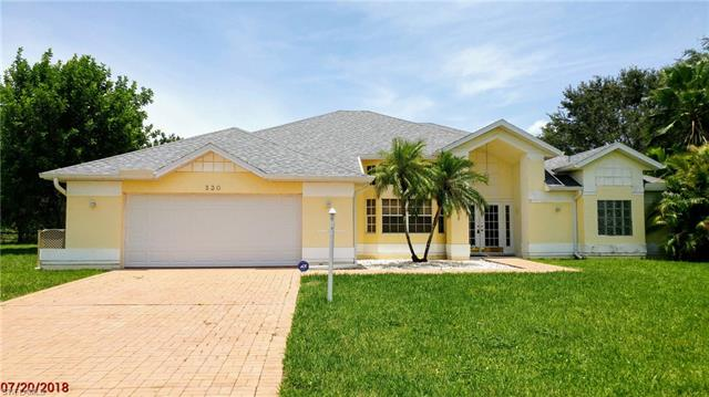 530 Whispering Wind Bend, Lehigh Acres, FL 33974