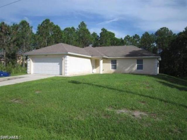 1123 Colonial St E, Lehigh Acres, FL 33974
