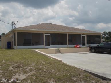 221-223 Ivan Ave S, Lehigh Acres, FL 33973