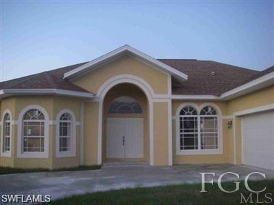 871 Cervantes St E, Lehigh Acres, FL 33974