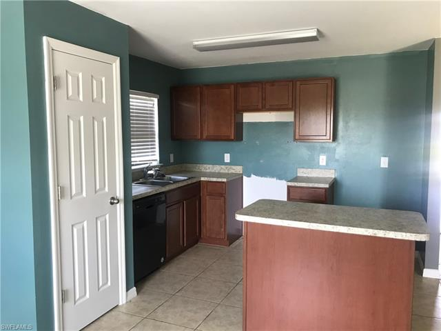 714 Center Lake St, Lehigh Acres, FL 33974