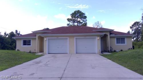 1040 Ainsworth St E, Lehigh Acres, FL 33974