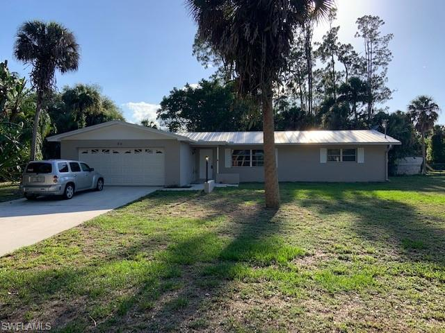 211 Lake Ave, Lehigh Acres, FL 33936