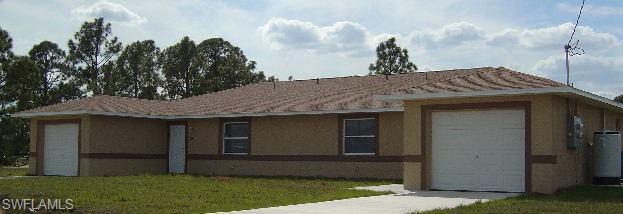 212/214 Hightower Ave S, Lehigh Acres, FL 33973