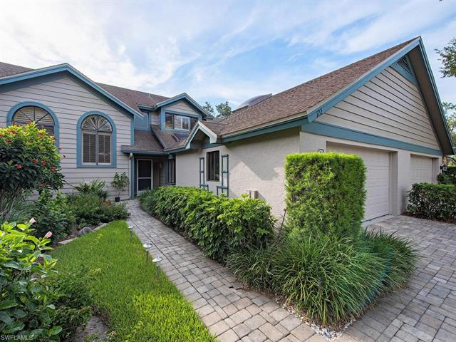 122 Water Oaks Way, Naples, FL 34105
