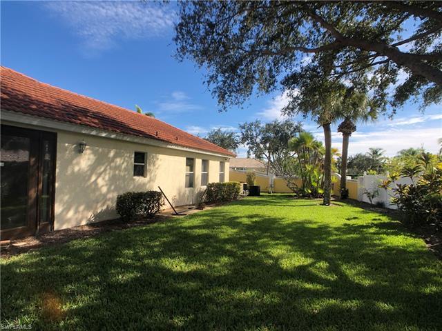 1503 Whispering Oaks Cir, Naples, FL 34110