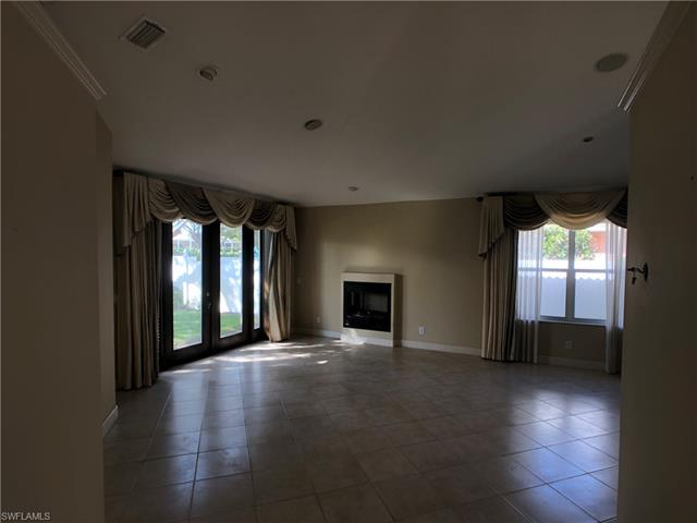1503 Whispering Oaks Cir, Naples, FL 34110